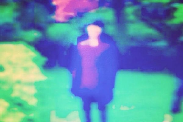 Blurred photograph of Rob Wilson, aka Colourful Sevens
